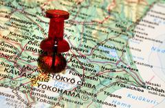 Pushpin on an atlas (tokyo) Stock Photos
