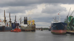 Tug boats tow the hopper dredger ship to the port 2 Stock Footage
