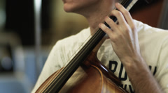CU TD Man playing cello, orchestra in background, Buena Vista, Virginia, USA - stock footage