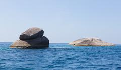 Rock in the ocean on the andaman sea Stock Photos