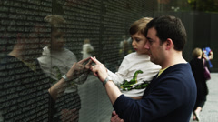 MS Father and son (4-5) at Memorial Wall, Vietnam Veterans Memorial, Washington Stock Footage