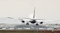 WS Rear view of passenger airplane landing on Ronald Reagan Washington National Stock Footage