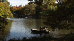 WS PAN HA Couple in row boat at Central Park lake, New York City, New York - stock footage