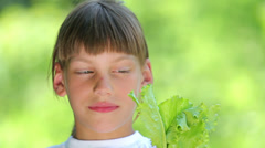 Boy eating a salad.The child makes a choice, vegetarianism. Stock Footage