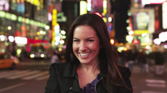 SLO MO MS DS R/F Woman photo messaging in Times Square at night, New York City, - stock footage