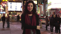 SLO MO MS DS Portrait of woman in Times Square at night, New York City, USA Stock Footage