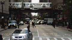 MS Busy street intersection and Chicago Transit Authority elevated train in the Stock Footage