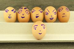 Happy and fun emoticons on empty eggshell Stock Photos