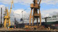 Stock Video Footage of Two ships during renovation in docks at Gdansk shipyard