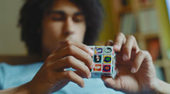 Closeup of a Rubik's Cube, which plays a man Stock Footage