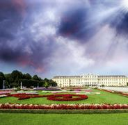 Stock Photo of Schoenbrunn Castle with park and garden flowers, Vienna. Beautif
