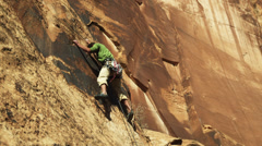 LA PAN WS Young man rock climbing / Moab, Utah, USA Stock Footage