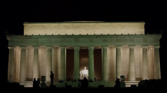 T/L WS Silhouettes of people in front of Abraham Lincoln Memorial illuminated at Stock Footage