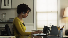 MS PAN Young woman working in office, using Bluetooth device/ Utah, USA Stock Footage