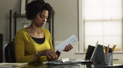 MS PAN Young woman reading letter in office/ Utah, USA Stock Footage