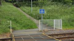 Tram passes warning sign, sheffield, england Stock Footage
