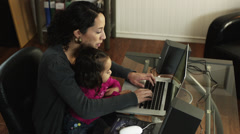 MS PAN HA Mother with daughter (2-3) using laptop at home/ Orem, Utah, USA - stock footage