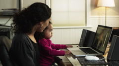 MS PAN Mother with daughter (2-3) using laptop at home/ Orem, Utah, USA Stock Footage