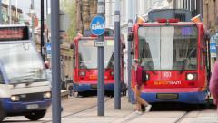 Tram leaves sheffield station, yorkshire, england Stock Footage