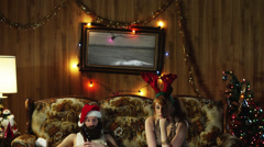 MS TD Bored woman with man in living room at Christmas/ Orem, Utah, USA Stock Footage