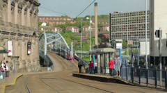 Tram pulls into sheffield station, yorkshire, england Stock Footage