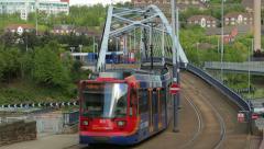 Tram crosses bridge, sheffield, yorkshire, england Stock Footage