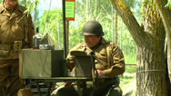 Stock Video Footage of US soldiers at command post during a WWII reenactment 2