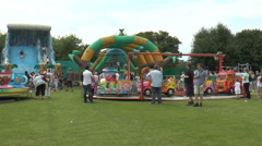 Children playing at an English country fair Stock Footage