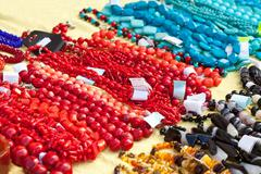 Bracelets and necklaces made of natural gems Stock Photos