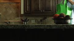 MS TU Man unloading grocery bag in kitchen / Orem, Utah, USA Stock Footage