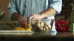 MS DS Man cutting yellow pepper in kitchen, mid section  / Orem, Utah, USA Stock Footage