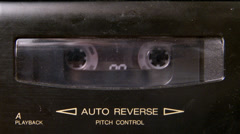 Cassette Tape Playing in a Cassette Deck Stock Footage