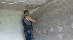 Apartment renovation. the man plasters a wall Stock Footage