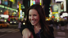SLO MO MS DS R/F Woman photo messaging in Times Square at night, New York City, Stock Footage