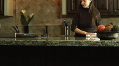 MS Mother doing housework, daughter (12-13) showing exam results / Orem, Utah, Stock Footage