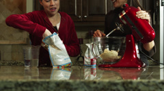 MS Mother and daughter (12-13) preparing food in kitchen / Orem, Utah, USA Stock Footage