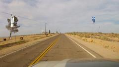 Driving Past Historic Route 66 Signs In Mojave Desert- Barstow CA Stock Footage