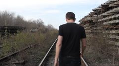 The young man goes on rails Stock Footage