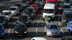 Heavy commuter traffic moves slowly along road, sheffield, yorkshire, england Stock Footage