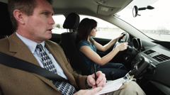 MS Girl (16-17) taking driving test, instructor grabbing steering wheel / Provo, Stock Footage
