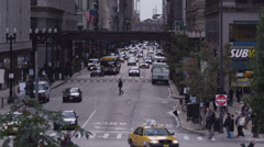 WS HA Busy street intersection and Chicago Transit Authority elevated train in - stock footage
