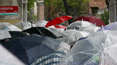 Crowd of people with umbrellas standing in queue to Ayasophya in Stanbul Turkey Stock Footage