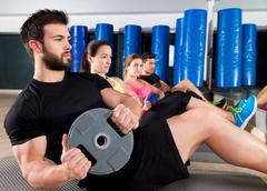 abdominal plate training core group at gym - stock photo