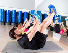 Abdominal plate training core group at gym Stock Photos