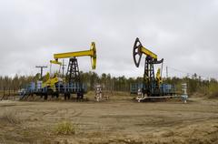 An oil well with a swinging rod pumping Stock Photos