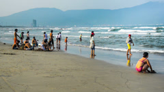 Local people like playing at sea in Da Nang, Vietnam Stock Footage