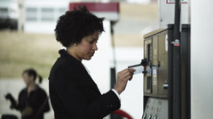 MS Woman paying at gas station / Orem, Utah, USA Stock Footage