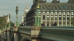 WS PAN Man and woman jogging on Westminster Bridge / London, UK Stock Footage