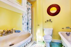 yellow bathroom interior - stock photo