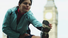 MS TU Woman stretching, top of Big Ben in background / London, UK Stock Footage